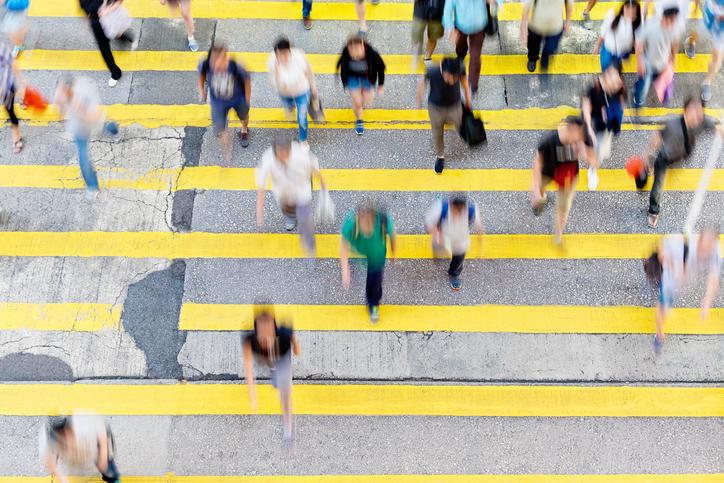 aerial view people crossing busy street